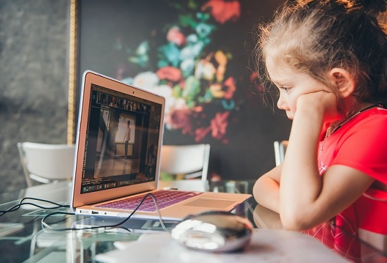 child learning remotely