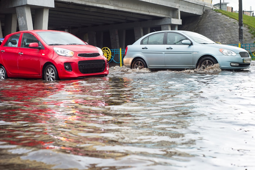 cars in flood under overpass