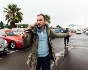 man looking for rental car